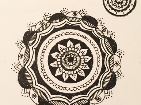 Hand-drawn Mandala or Zentangle.