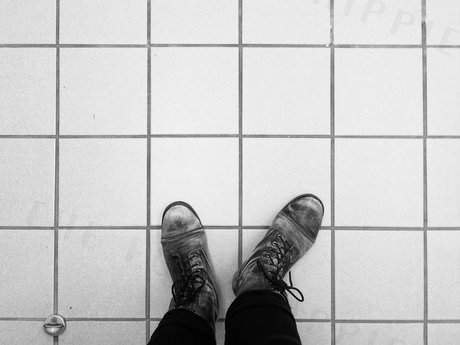 Feet on floor stock photo - digital
