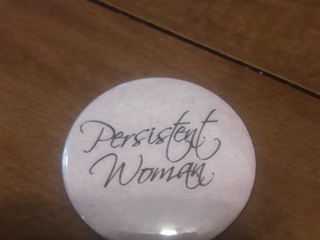 Persistent Woman Button