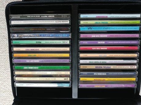 24 inspirational Christian CDs/case