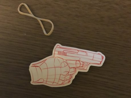 Sticker- hand holding toy gun