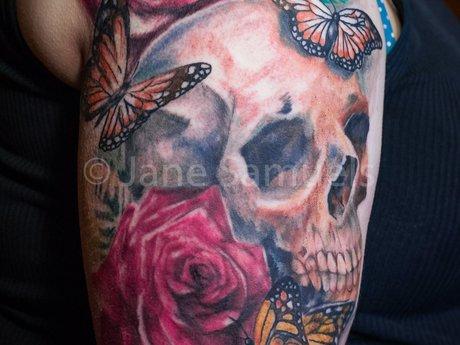 Licensed custom tattooing or design