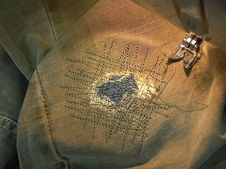 mending clothes with holed