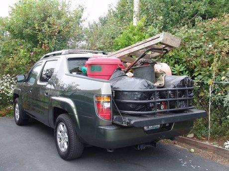 A guy, a dog, a truck