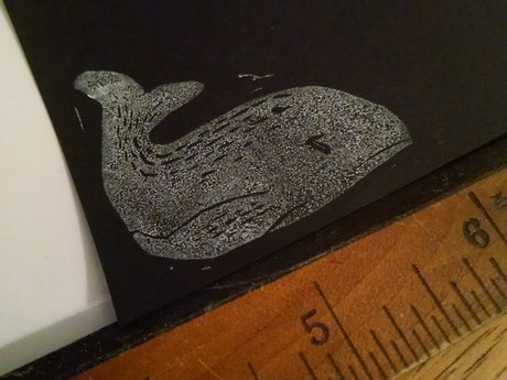 Mini linocut: skeptical whale